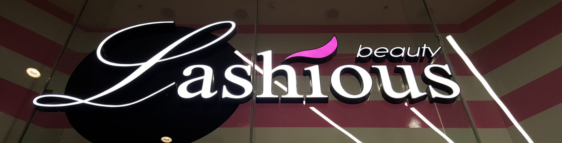 Large built up illuminated letters on glass
